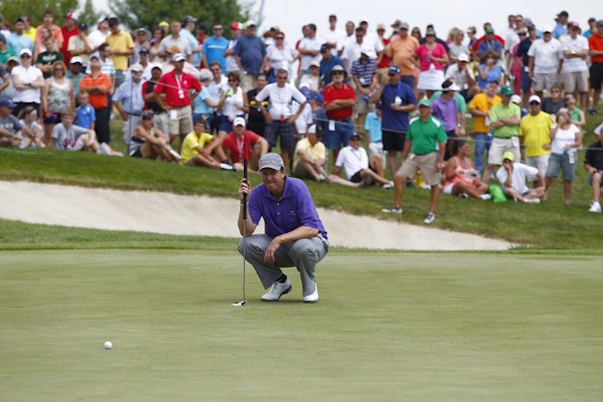 SILVIS, IL - JULY 14: J.J. Henry lines up a putt on the eighth green during the final round of the John Deere Classic held at TPC Deere Run on July 14, 2013 in Silvis, Illinois. (Photo by Michael Cohen/Getty Images)