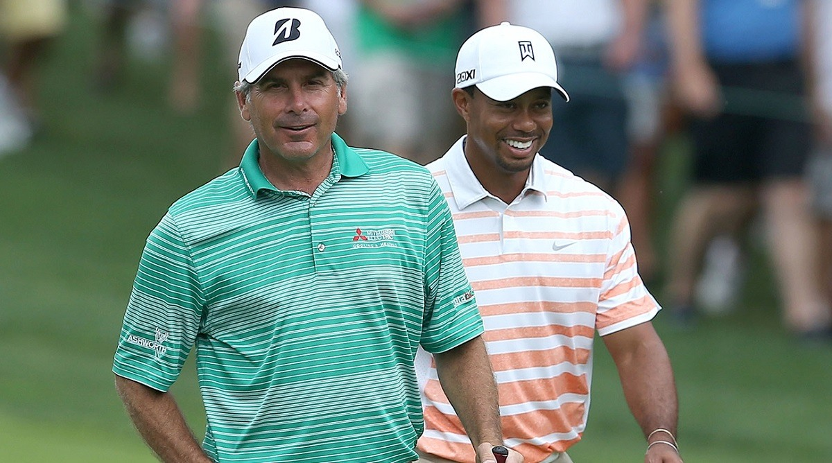 DUBLIN, OH - MAY 31: Fred Couples and Tiger Woods walk down the fairway on the par 4 1st hole during the second round of the Memorial Tournament presented by Nationwide Insurance at Muirfield Village Golf Club on May 31, 2013 in Dublin, Ohio. (Photo by Andy Lyons/Getty Images)